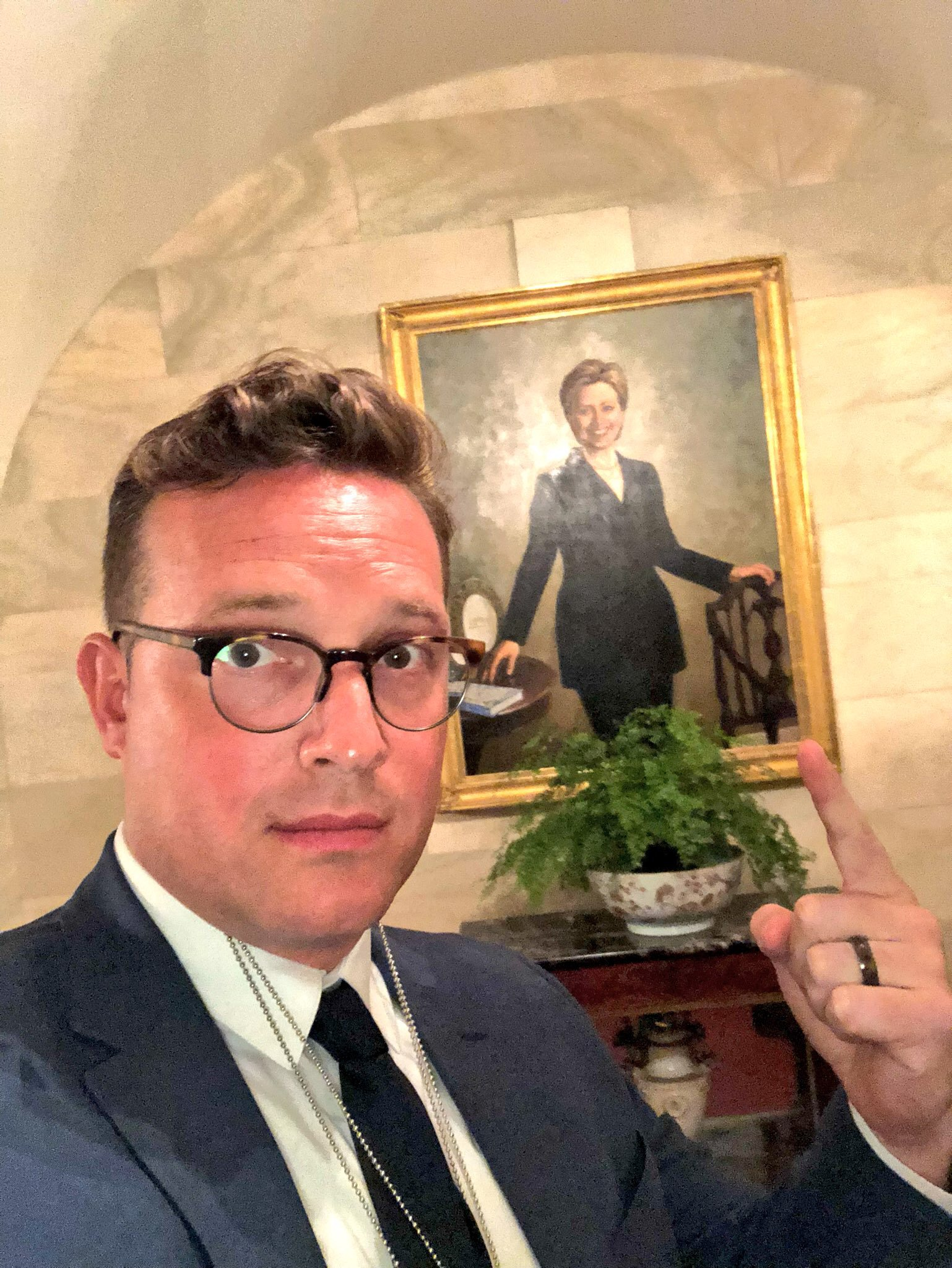 Benny takes a selfie by the Hillary portrait during the journey to the SCOTUS annoucement. Photo credit to Benny Johnson at The Daily Caller.