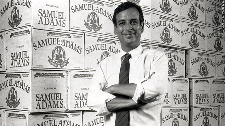 Jim Koch with original cases of Samuel Adams beer. Photo courtesy of money.com.