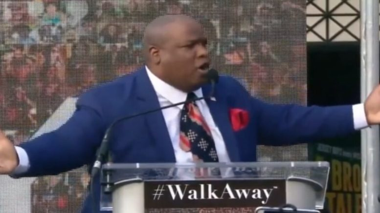Pastor Burns speaks at the #WalkAway March in D.C. ahead of the 2018 midterms. Photo credit to US4Trump screen shot.